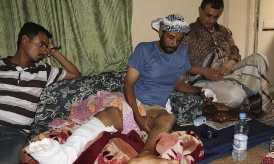 People visit a man injured during a recent clashes between tribal fighters who support the Saudi-led campaign and Shia rebels, at his home in Taiz, Yemen.