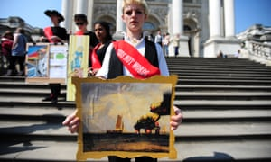 A Climate Rush Activists holds a painting of the Deepwater Horizon disaster outside the Tate Britain in protest over sponsorship of the Tate museums by BP, 20 April 2011.