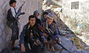 Armed men from forces loyal to Yemen's exiled president in the city of Taez during ongoing clashes with Houthi rebels.