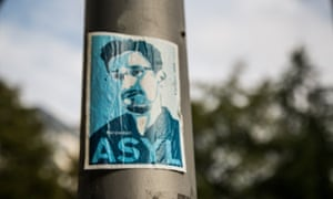 A Berlin poster campaigns to grant asylum to whistleblower Edward Snowden, who revealed the extent of US and UK government surveillance