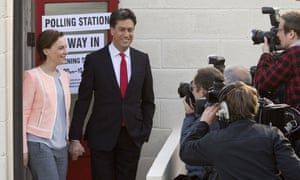 Ed Miliband arrives to vote with his wife Justine on 7 May 2015.