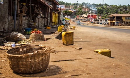 A usually busy street is deserted as Sierra Leone enters the second day of a three day country wide lockdown on movement of people due to the Ebola virus in the city of Freetown
