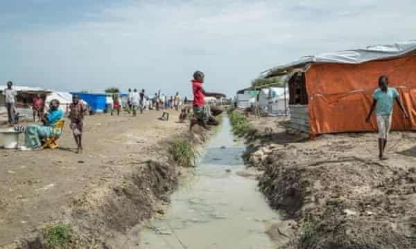 Child jumps a drainage ditch in Malakal POC, Upper Nile