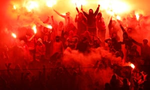 Galatasaray fans light flares to celebrate their goal against Fenerbahce during the game on 6 April 2014.