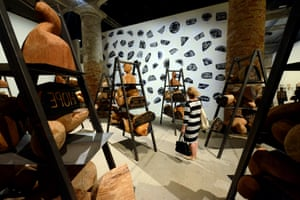 in the Arsenale - Barthélémy Toguo:  Urban Requiem, 2015 . Installation with steel ladders, iroko wooden stamps, ink prints on paper