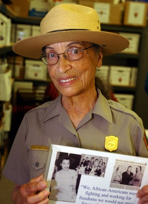 Ranger Betty Soskin with a photo of herself has a young woman.