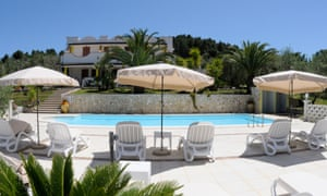 At Poggio di Luna in Puglia meals are served on the terrace overlooking the pool and colourful gardens