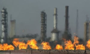 Fires flare off the gas from crude oil at Iraq's oldest oil processing plant in the town of Baba Gurgur.