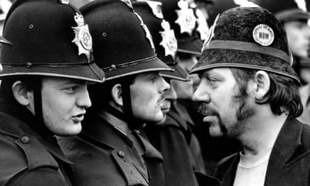 A striking miner faces a line of police at the Orgreave pit during the miners' strike in 1984. Photograph: Don McPhee