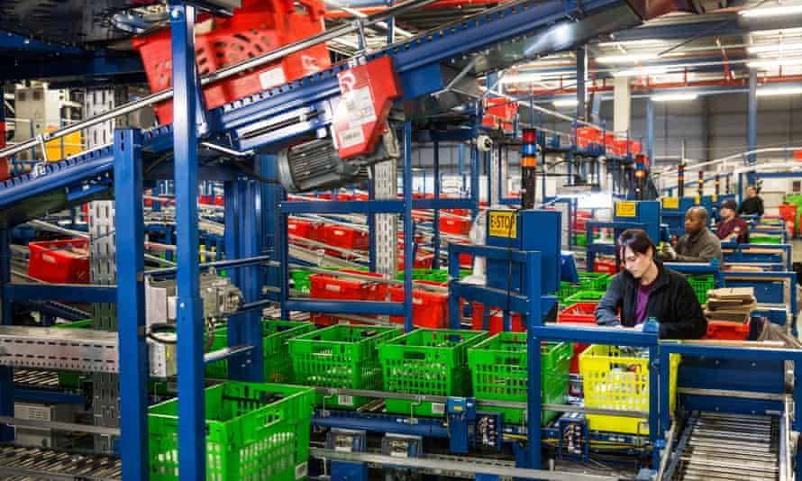 Ocado's current Order Storage Retrieval machine, where partially or fully completed basket are sorted, depends on human staff.