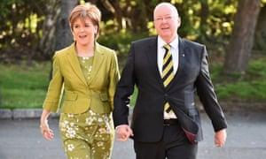 Nicola Sturgeon, votes with her husband Peter Murrell in Glasgow, Scotland.