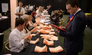 Labour party officials monitor the count at the counting centre at Doncaster racecourse.