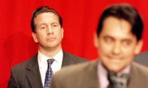 Conservative defence minister Michael Portillo, left, seems at loss as Labour's Stephen Twigg makes his victory speech after winning Enfield Southgate in 1997.