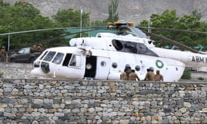 Pakistani soldiers gather beside an army helicopter at a military hospital where victims of a helicopter crash were brought for treatment in Gilgit.