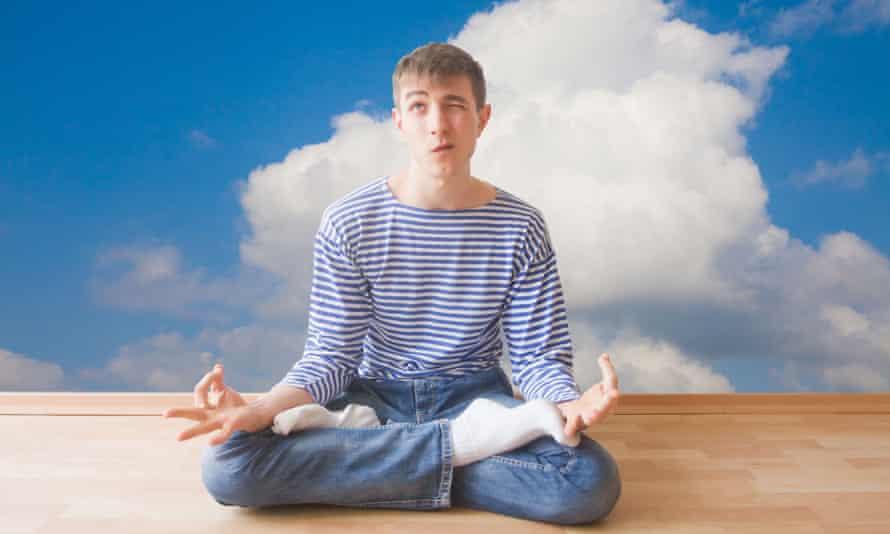 Man sitting cross legged in meditation pose
