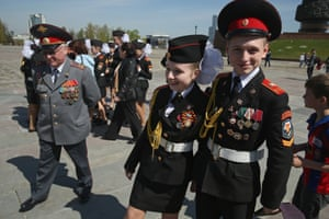 Military cadets arrive at the Eternal Flame at the grand memorial to Soviet soldiers killed during the Second world war at Victory Park in Moscow