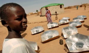 Sudanese refugees stand around solar stoves during a training session in Iridimi camp, north-eastern Chad