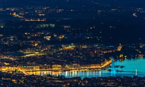 The jet d'eau fountain in Geneva, Switzerland is illuminated with blue light to celebrate VE day