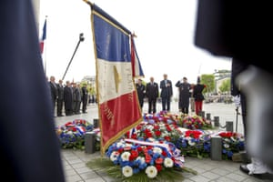The US secretary of state, John Kerry, and French foreign minister, Laurent Fabius, pay their respects at the tomb of the Unknown Warrior in Paris, during a wreath-laying ceremony during events marking the 70th anniversary of Victory in Europe Day (VE Day)