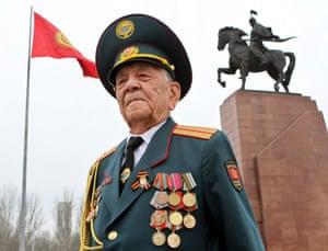 Second world war veteran, Asek Urmanbetov, stands in the central square in Bishkek, Kyrgyzstan