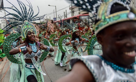 Traditional dance groups march in the carnival in Lagos