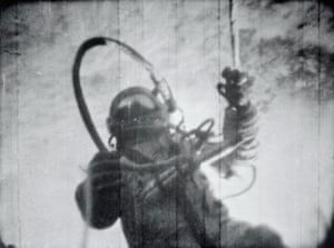 Leonov is pictured uses the tether to pull himself back to the ship. The picture was taken by the ship's commander Pavel Belyaev, through a window.