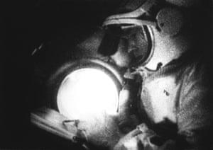 A keen artist, Alexei Leonov draws a sketch of the Earth, while aboard Voskhod-2.