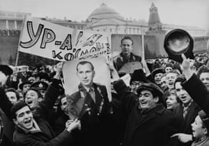 People celebrate the success of the Voskhod 2 mission in Moscow.