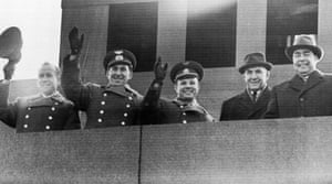 Leonov and Belyayev, far left and left, wave to crowds from a balcony in Red square. In the centre is Yuri Gagarin, the first man in space. To his right, premier Alexei Kosygin, with Soviet leader Leonid Brezhnev on the far right of the picture.