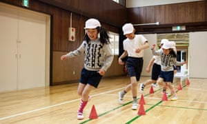 Students exercise in the gym at Aone elementary school