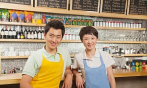 Two baristas at a coffee shop, Beijing.