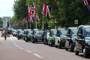 Black cab and licensed taxi drivers protest against Uber on The Mall, London.