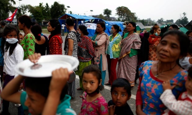 Nepal's earthquake survivors queue for food at a refugee camp in Kathmandu.