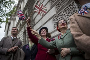 Members of the crowd in 1940s clothes wave flags during a tribute at the Cenotaph to begin three days of national commemorations to mark the 70th anniversary of VE Day in London
