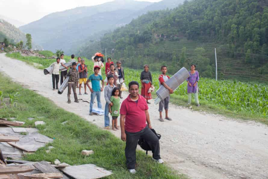 Nakul Khadka (front) with some Jalbire villagers for whom he managed to procure supplies, 2 May.