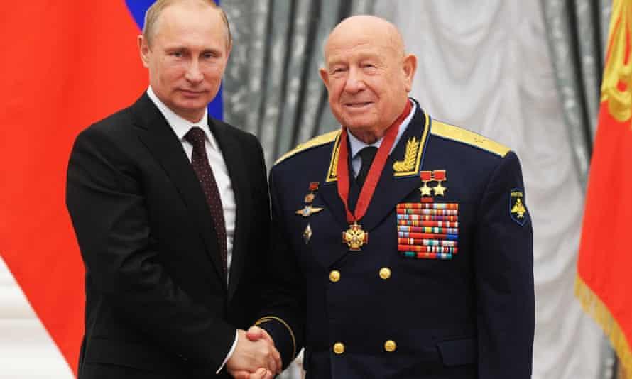 Russian president Vladimir Putin and Russian cosmonaut Alexei Leonov, right, at an awarding ceremony in Moscow's Kremlin.