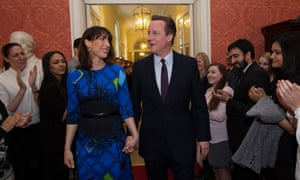 David Cameron and his wife Samantha are applauded by staff on entering 10 Downing Street.