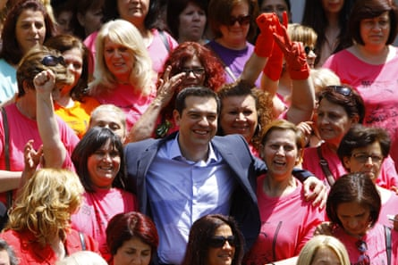 Gloves off … Alexis Tsipras last week with cleaners celebrating victory in their two-year fight to win back their jobs at Athens's finance ministry.