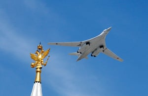 A Tu-160 heavy strategic bomber flies overhead