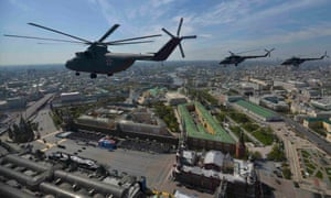 Russian Mil Mi-26 Halo helicopters fly over Red Square