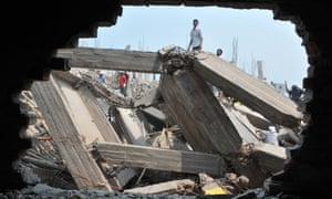 Rescuers work at the collapsed Rana Plaza in Dhaka in April 2013.