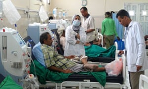 Yemen medical staff and patient at an Aden hospital