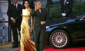 U.S. actor George Clooney and his wife, Amal, arrive for the Japan premiere of Disney's latest film Tomorrowland in Tokyo last week.