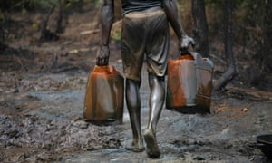 A man works at an illegal oil refinery site near river Nun in Nigeria's oil state of Bayelsa.