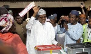 Muhammadu Buhari casts his vote in his home town of Daura, northern Nigeria Saturday, 28 March.