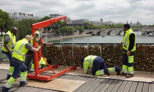 "Workmen remove iron grills covered with ""love locks"" on the Pont des Arts."