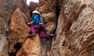 A young Palestinian woman learning to rock climb on the cliffs above Ein Qiniya outside the city of Ramallah on the West Bank. Despite an active climbing community in Israel, outdoor climbing venues for Palestinians have only been developed in the last twelve months.