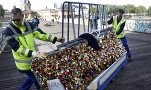 City municipal employees remove the barriers with love padlocks on the Pont des Arts.