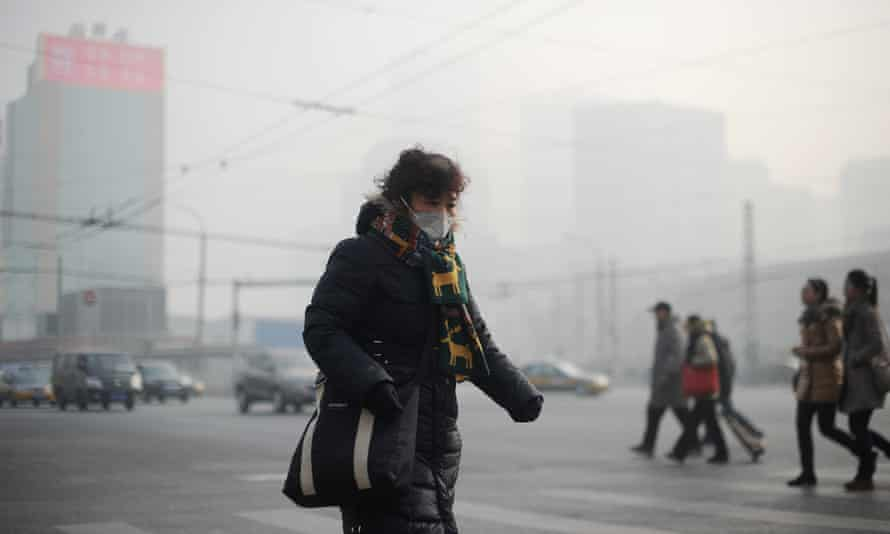 A woman wearing a face mask to protect against smog in Beijing in January 2014.