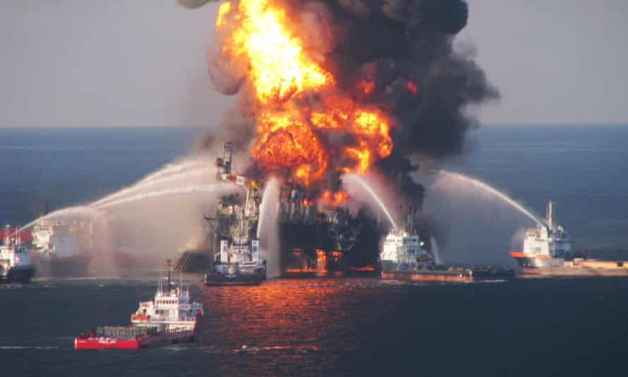 Fire boats battle a fire at the offshore oil rig Deepwater Horizon 21 April 2010 in the Gulf of Mexico.